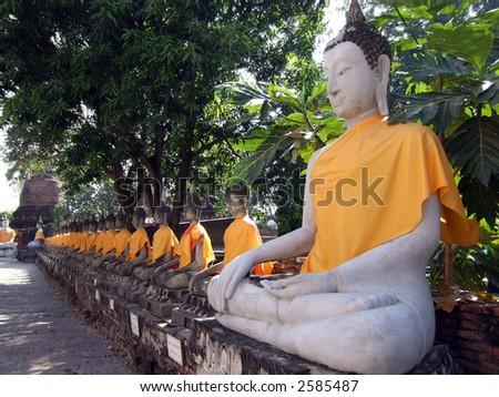 Buddhas at the temple of Wat Yai Chai Mongkol in Ayutthaya near Bangkok, Thailand.