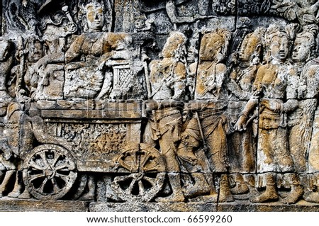 Buddhist bas-relief detail whit charriot in borobudur temple site - stock photo