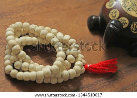 Buddhist beads. Rosary or beads from the sacred tree of Tulasi with a red tassel and a Chinese tortoise, a souvenir. #1344510017