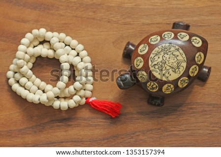 Buddhist beads. Rosary or beads from the sacred tree of Tulasi with a red tassel and a Chinese tortoise, a souvenir. #1353157394