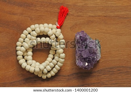 Buddhist beads. Rosary or beads from the sacred tree of Tulasi with a red tassel and and natural stone amethyst. #1400001200
