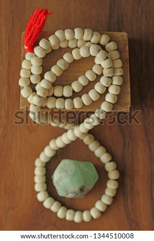 Buddhist beads. Rosary or beads from the sacred tree of Tulasi with a red tassel and natural stone beryl emerald. #1344510008
