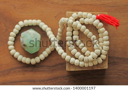 Buddhist beads. Rosary or beads from the sacred tree of Tulasi with a red tassel and natural stone beryl emerald. #1400001197