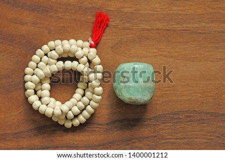 Buddhist beads. Rosary or beads from the sacred tree of Tulasi with a red tassel and natural stone beryl emerald. #1400001212