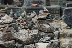Buddhist cairns gathered on the ruins of Angkor Wat temples