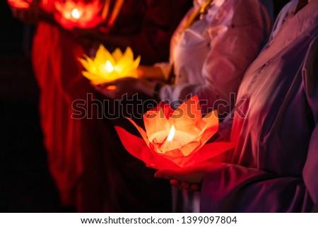 Buddhist hold lanterns and garlands praying at night on Vesak day for celebrating Buddha's birthday in Eastern culture Сток-фото ©