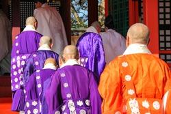 Buddhist monks and Shinto priests entering the main shrine. Chinekisai festival, Usa shrine, Oita prefecture, Kyushu, Japan.