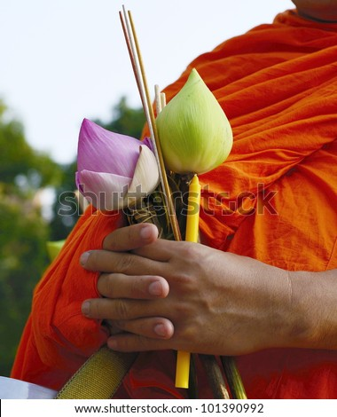 Buddhist monks be receive food in the morning at Chiangmai, Thailand.