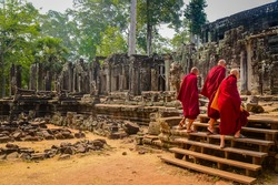 Buddhist monks enter the Bayon Temple at Angkor Wat, Siem Reap, Cambodia