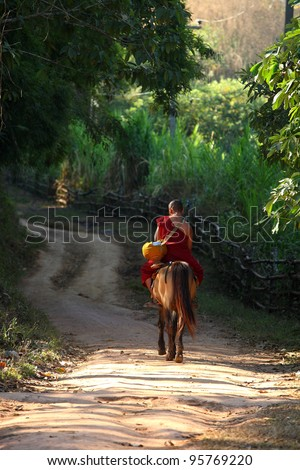 Buddhist monks riding horse in north of Thailand