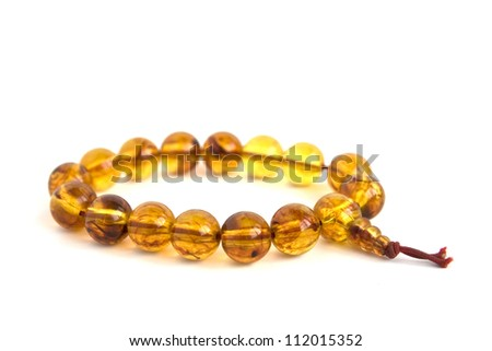 Buddhist necklace made of amber isolated on white background