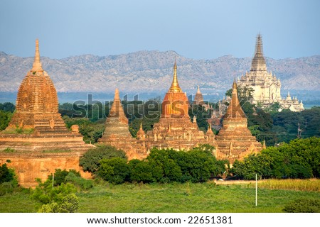 Buddhist Pagodas after sunrise, and the wonderful Gawdawpalin Pahto, Plain of Bagan, Myanmar.