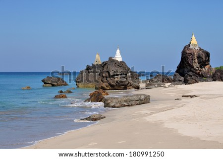 Buddhist pagodas on top of rocks found on the beach of Ngwe Saung west coast of Myanmar