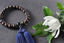 Buddhist prayer beads (for men) and a chrysanthemum.