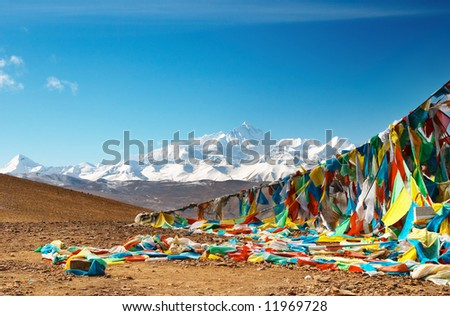 Buddhist prayer flags and mount Everest on background