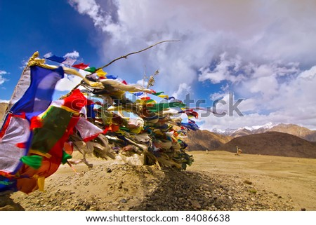 Buddhist prayer flags flying with high winds in the Himalaya mountains of Ladakh, Jammu and kashmir, India