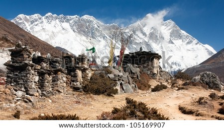 buddhist prayer walls or prayer stupas in nepal on the way to everest base camp - Lhotse, Nuptse and top of Mount Everest