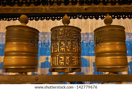 Buddhist prayer wheels in Swayambhunath. Swayambhunath is an ancient religious complex atop a hill in the Kathmandu Valley.