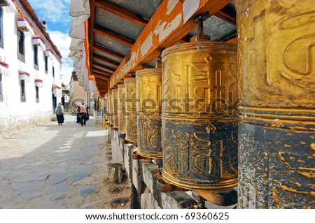 Buddhist prayer wheels in Tibetan monastery