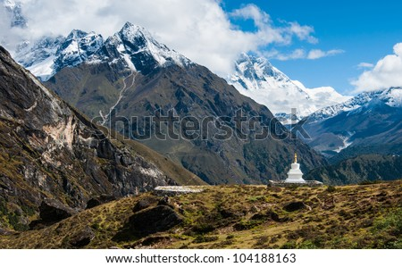 Buddhist stupe or chorten and Lhotse peaks in Himalayas. Religion in Nepal