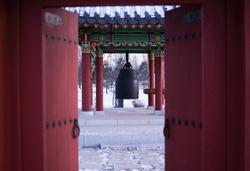 Buddhist temple bells. Ring bell. Winter in korean garden.
