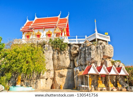 Buddhist temple on mountain, Blue sky background