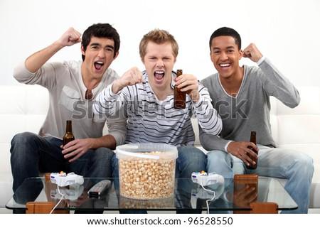 buddies watching football match on telly