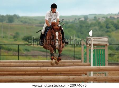 BUDESHTI - JUNE 15: Rider in the jumping show, stage of the Moldavian Jumping Championship , june 15, 2008 in Budeshti, Moldova.