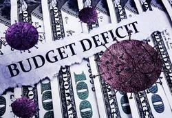 Budget Deficit news headline and Coronavirus on hundred dollar bills