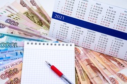 budget planning, sales strategy for the next year, Notepad and money, calendar for 2021