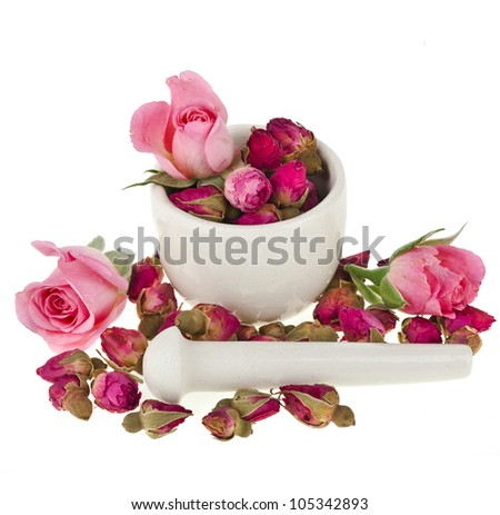 buds of the tea roses flowers in a mortar and pestle