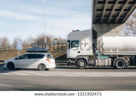 Budweis, Czech - February 16, 2019: A Cargo transport truck also known as lorry speeding through the city  #1315302473