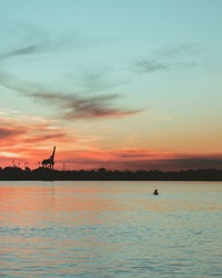 Buenos Aires -  man fishing during sunset in winter