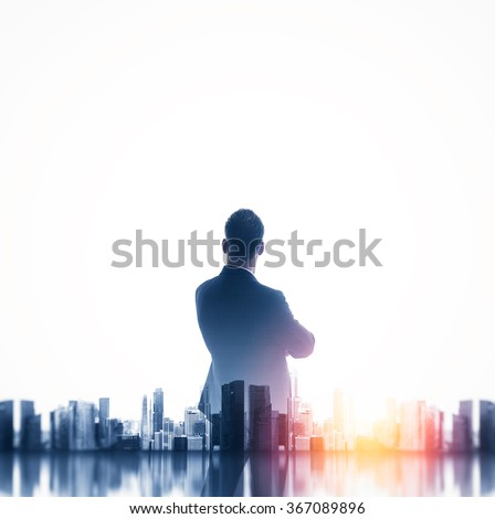 Buesinessman wearing classic suit and looking cityscape. Double exposure.