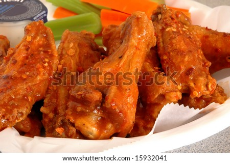 Buffalo chicken wings with celery and carrots