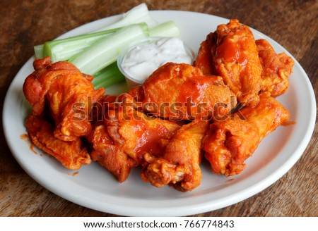 Buffalo sauced chicken wings with celery and chunky blue cheese dressing.