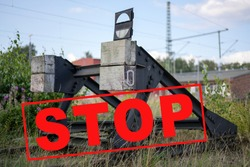 Buffer block at the end of a railway track with text Stop, concept for strike or decommissioning of railroad lines, selected focus