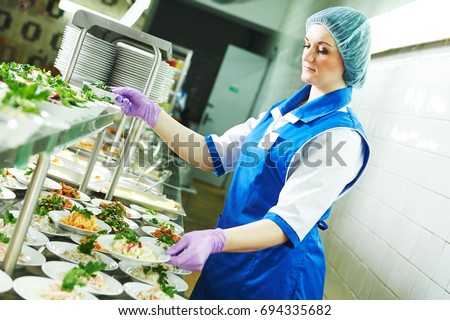 buffet female worker servicing food in cafeteria Stock photo ©