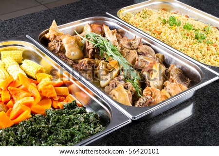 buffet style food in trays
