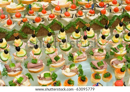 buffet table - a lot of canapes and sandwiches, shallow DOF - stock photo
