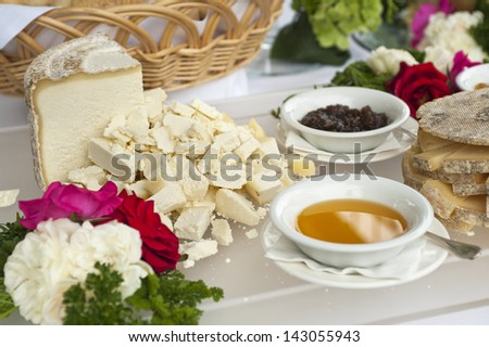 buffet table with cheese, honey and jam