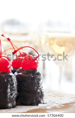 Buffet table with chocolate cake and champagne