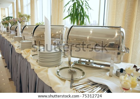 Buffet Table with dishware waiting for guests
