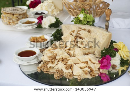 buffet table with Parmesan cheese in pieces with nuts