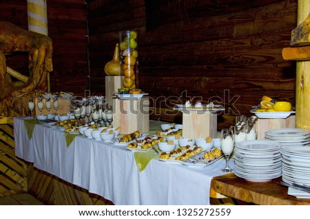 buffet with desserts. various desserts, pies and plates #1325272559