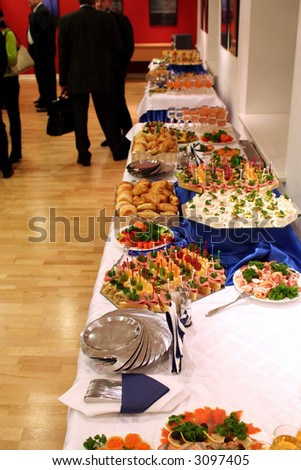 Buffet with snacks on tables at presentation