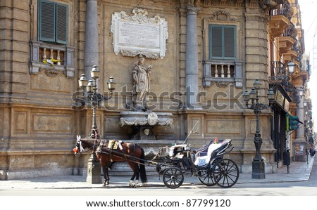 Buggy in the Quattro Canti, one of the octagonal four sides of Baroque square in Palermo - Italy
