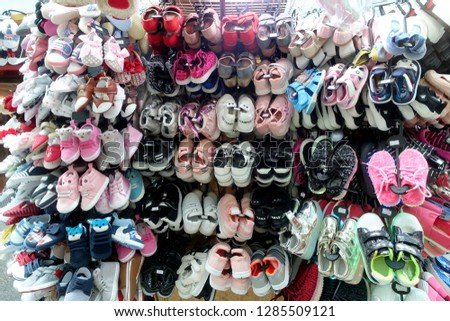Bugis, Singapore - January 13, 2019 : assorted children's shoes on display for sale in a store at Bugis Junction