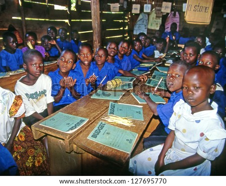 BUIKWE REGION, UGANDA - JULY 26: An unidentified children at the village school on July 26, 2004 in Buikwe region, Uganda. Most children can walk to school thanks to foreign charity