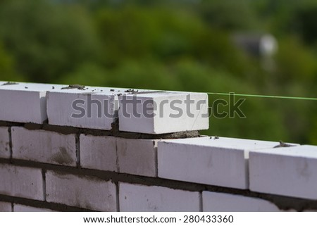 Build a wall brick by level